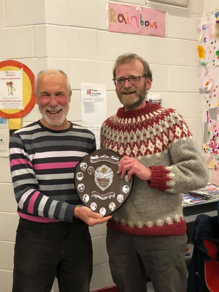Ian Hamilton receives the V50 trophy from Ewen Rennie